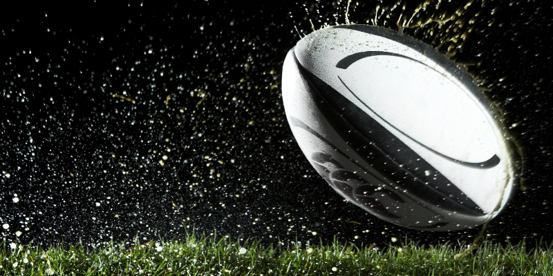 A rugby ball in rain