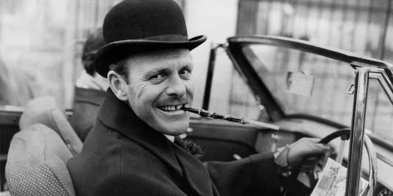 Terry-Thomas in a car